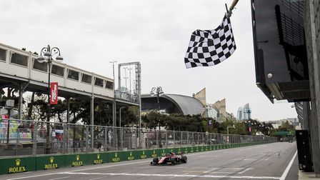 George Russell greeting the chequered flag in the second FIA Formula Two race at the Baku Circuit, A
