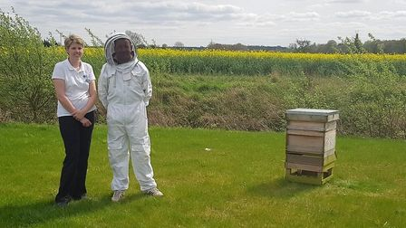 Emma Shaw and Graham Battershill with the new hive. Picture: NORFOLK HOSPICE