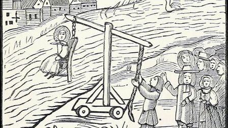 Illustration a ducking stool from an 18th century chapbook reproduced in Chap-books of the eighteen