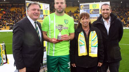 Grant Hanley of Norwich receives his trophy for coming 2nd in the Player Of The season awards before