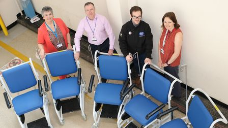 With five of the new fleet of indoor wheelchairs are (from left) Trust fundraising executive Laurenc