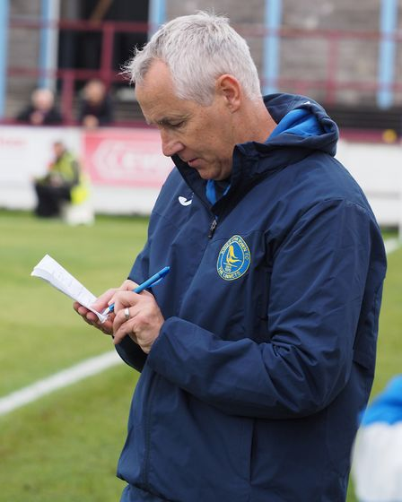 Lynn boss Ian Culverhouse busy taking notes during the game at Weymouth. Picture: Geoff Moore/Focus