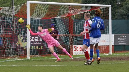 Lowestoft force the Dorking goalkeeper into a save. Picture: Shirley D Whitlow