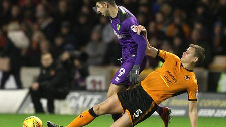 Ryan Bennett tackles former City team-mate Nelson Oliveira during the 2-2 draw at Molineux in Februa
