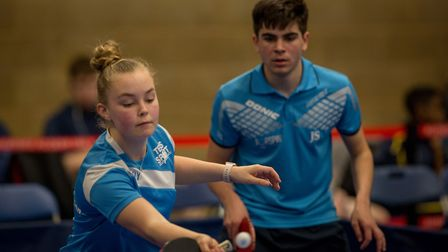 Mollie Patterson in mixed doubles action. Picture: Michael Loveder