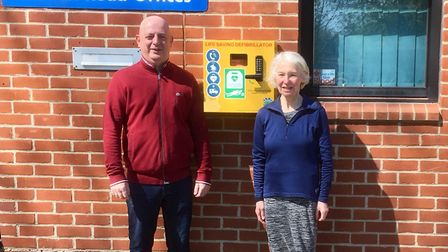 Paul Pottle and Heather Edwards with the Colman Road Defibrillator. Photo: Trevor Browne