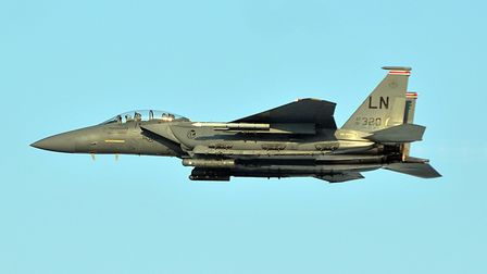Two F-15 fighter jets carrying out high performance manoeuvres were involved in a near-miss with a r