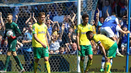 The Norwich players look dejected after conceding their side's 5th goal during the Sky Bet Champions