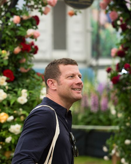 Television presenter Dermot O'Leary visits Peter Beales Roses award winning stand at Chelsea Flower