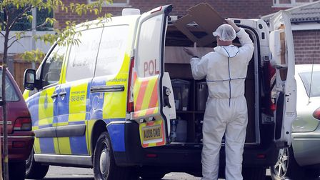 Forensic teams combed Mr Hogan's property. Picture: Matthew Usher