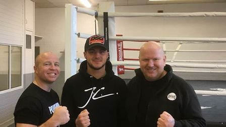 Joe Steed with trainers Jon Thaxton, left, and Graham Everett. Picture: Archant