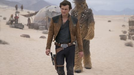 Alden Ehrenreich as Han Solo and Joonas Suotamo is Chewbacca in Solo: A Star Wars Story. Photo: Luca