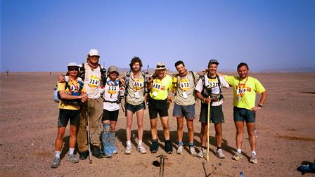 Carl Marston, fourth from left, and the rest of his tent line up before the final stage. Picture: Ca