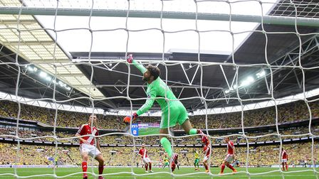 Dimitrios Konstantopoulos can only watch as a shot by Bradley Johnson rebounds off the crossbar Pict