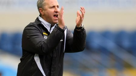 Neil Adams has become a key component in Norwich City's bid to turn promising young players into fir