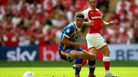 Norwich City loanee Ben Godfrey in action for Shrewsbury Town at Wembley, as they take on Rotherham