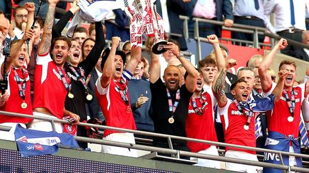 Rotherham United manager Paul Warne celebrates Championship promotion with the League One play-off f