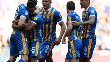 Norwich City loanees Carlton Morris (9) and Ben Godfrey (4) join in the Shrewsbury Town celebrations