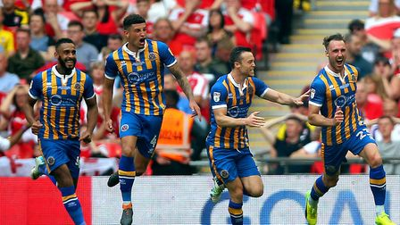 The expressions say it all, as Norwich City loanee Ben Godfrey (4) joins in with the Shrewsbury Town