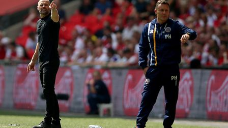 Former Millers team-mates, Rotherham United manager Paul Warne (left) and Shrewsbury Town boss Paul