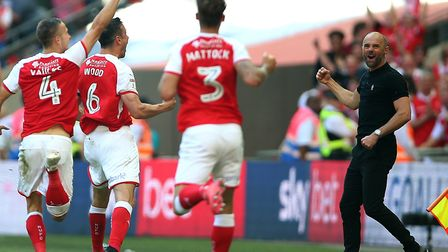 Rotherham United manager Paul Warne beams as Richard Wood celebrates his extra-time winner over Shre
