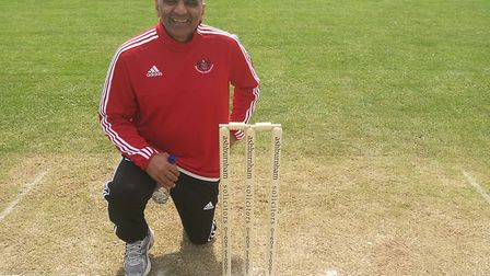 Sprowston B captain Sudi Trivedi pictured with the Norfolk League's new stumps bearing the name of