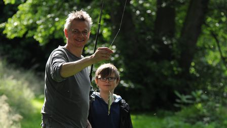 Leo and dad, Russ, show even jam jar fish can be fun. Picture: John Bailey