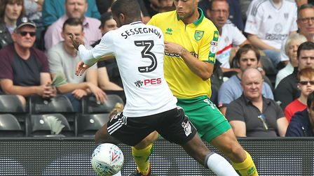 Yanic Wildschut tries to burst past Ryan Sessegnon on the opening weekend at Fulham. Picture: Paul C