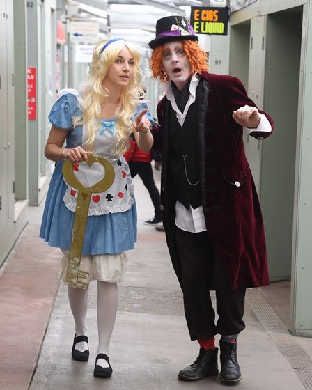 Alice (Katherine Vince) and the Mad Hatter (Paul Goldsmith) on the treasure trail questions around t