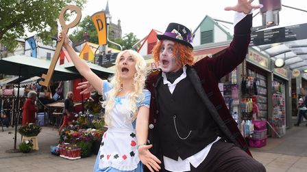 Alice (Katherine Vince) and the Mad Hatter (Paul Goldsmith) at the market for Norwich in Wonderland.