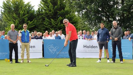 Visually impaired golfer Robin Sizeland tees off the NNAB golf day. Picture: Newman Associates