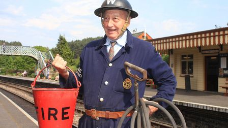 Dont panic! Dad's Army fire warden John Simons with bucket and hose at the readyPhoto: KAREN BETHELL