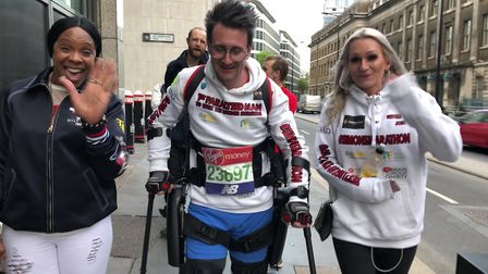 Wearing robotic legs lent for the challenge, Simon Kindleysides has become the first paralysed man t
