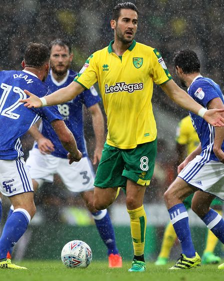 Norwich City midfielder Mario Vrancic is fouled while fending off Birmingham attentions at Carrow Ro