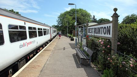 The Abellio Greater Anglia 156 at West Runton station during the course of the Norwich - Sheringham