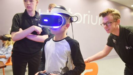 Kieran Barker enjoying the VR game at the 2018 Norwich Gaming Festival.Picture: Nick Butcher