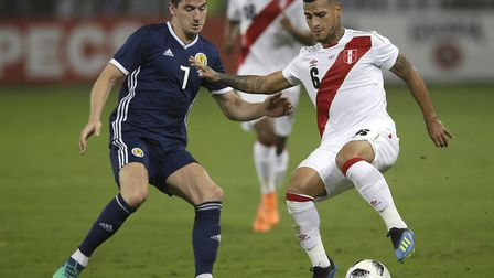 Peru's Miguel Trauco, right, fights for the ball with Scotland's Kenny McLean during a friendly in L