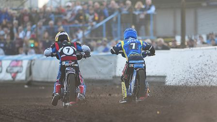 Lewis Kerr and (L) Bradley Wilson-Dean flying out of the gate in heat eight. Picture: Ian Burt