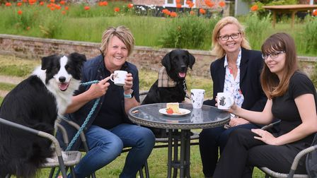 Kathryn Cross, second right, at the dog friendly cafe at her new business hub for all things canine