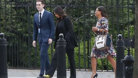 Kim Kardashian, center, arrives at the security entrance of the White House. Picture Pablo Martinez