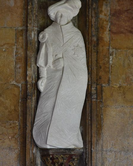 Statues of the Queen and Prince Philip are installed in the cloisters at the Cathedral .Byline: Son