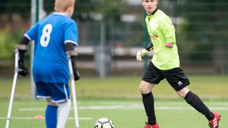 Kieran Lambourne, right, is a goalkeeper for Peterborougyh United's amputee team. Picture: LAJ Photo