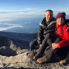 Mark Thompson with Lydia Bright at the summit of Mount Kinabalu Credit: Barnado's