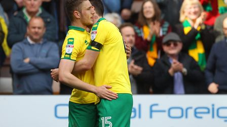 Timm Klose gives Dennis Srbeny a hug after scoring his one and only Norwich City goal - a moment to