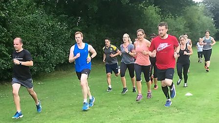 Neil Featherby puts his runners through their paces at the Field of Pain. Picture: Neil Featherby
