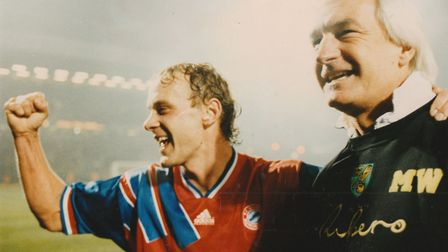 Mike Walker (right) and Jemery Goss celebrate Norwich City's Uefa Cup success over Bayern Munich bac