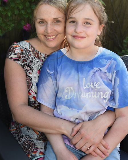 Ella-Grace Honeyman celebrating her 11th birthday, pictured with her mum Laura, at their home in Hev