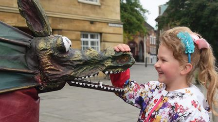Emma Darkintaite, six, meets Snap the Dragon before the procession to mark the start of Norwich's ci