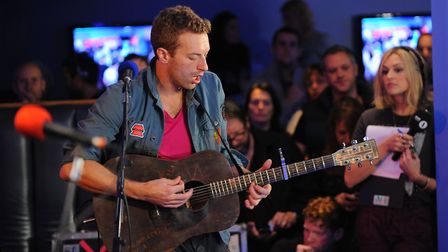Chris Martin on guitar as Coldplay play for Radio 1's Live Lounge at the UEA, with Fearne Cotton, ri