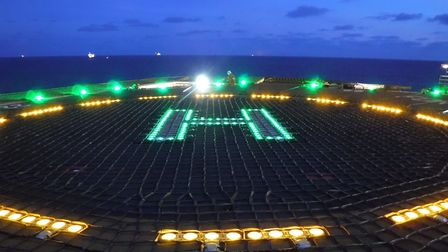 An illuminated Circle H helideck net. Picture: TMS Media